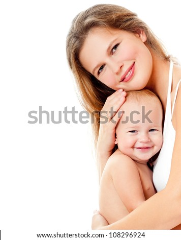 Young mother hugging baby