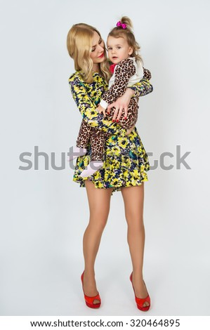 Young mother hugging her child - stock photo