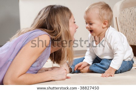 Young mother is playing with her son