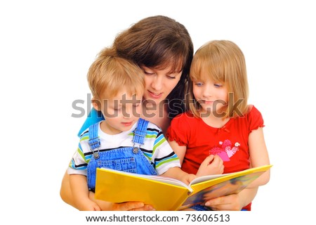 Young mother is reading a book with her kids - stock photo