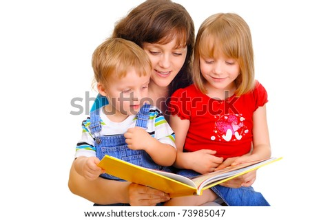 Young mother is reading a book with her kids