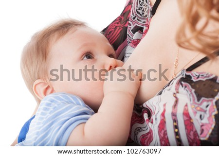 Young mother nurses the baby on a white background