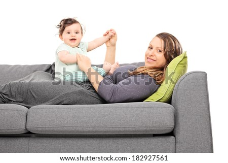 Young mother playing with her baby daughter isolated on white background