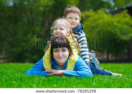 young mother playing with his son and daughter