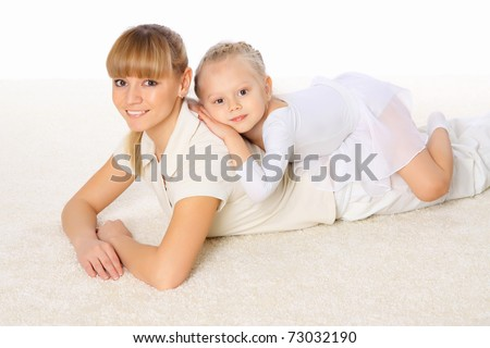 Young mother spend time with her little daughter - stock photo