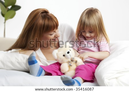young mother spending  quality time with her daughter  before bedtime