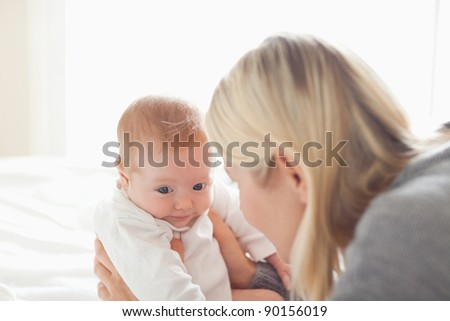 Young mother taking care of her newborn - stock photo
