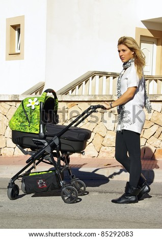 Young Mother walking with a new design stroller
