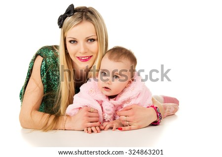 young mother with a baby cuddling - stock photo