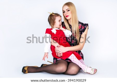 Young mother with a baby on the background - stock photo
