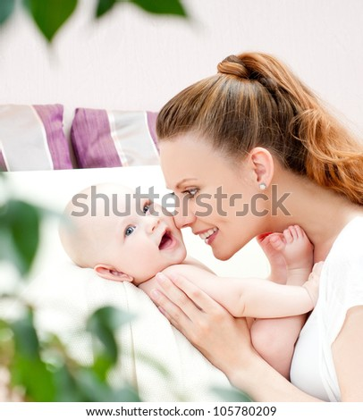 young mother with a charming baby - stock photo