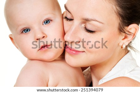Young mother with a charming baby.Happy family. - stock photo