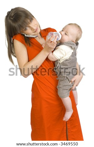 Young mother with baby boy on hand. Feeding baby and talking by mobile phone. Looking at camera. Isolated on white - stock photo