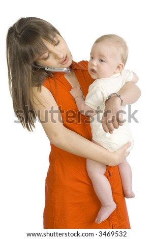 Young mother with baby boy on hand. Talking by mobile phone. Isolated on white - stock photo