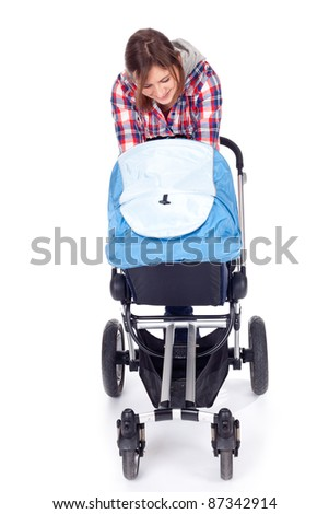 young mother with baby buggy (stroller), white background - stock photo
