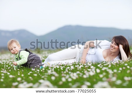 Young mother with child outside on a summer day - stock photo
