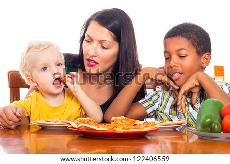 Young mother with children eating pizza, isolated on white background.