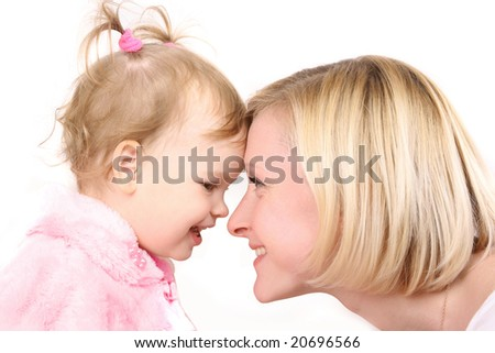 young mother with cute little daughter - stock photo