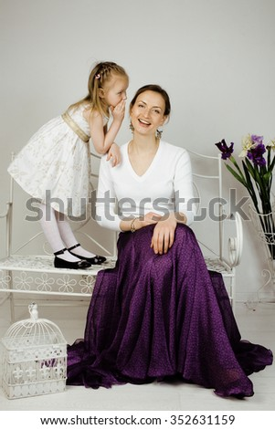 young mother with daughter at home white bright interior, happy family - stock photo