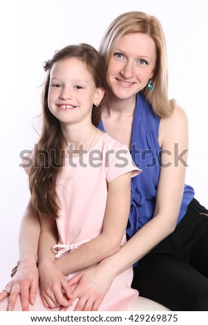 young mother with daughter isolated on white - stock photo