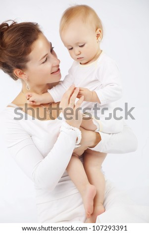 Young mother with her baby - stock photo