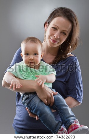 Young mother with her baby girl. Cute image with natural faces. - stock photo