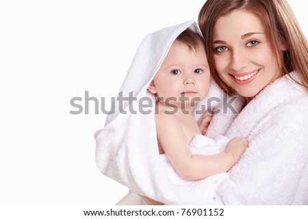 Young mother with her baby in a white towel - stock photo