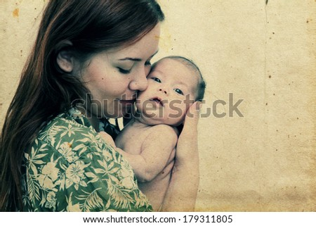 young mother with her baby. Photo in old image style - stock photo