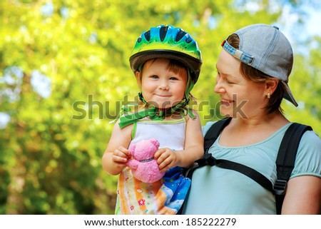 Young mother with her daughter ready for the bike ride - stock photo