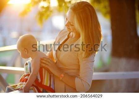 Young mother with her little baby - stock photo
