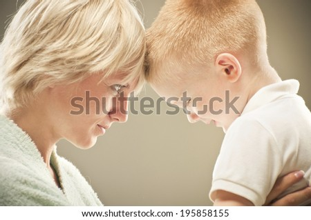 young mother with her son - stock photo