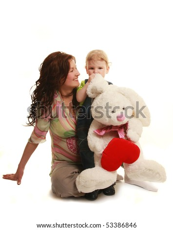 young mother with her son and white rabbit - stock photo