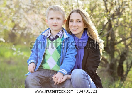 young mother with her son five years, laughter, outdoor, fun