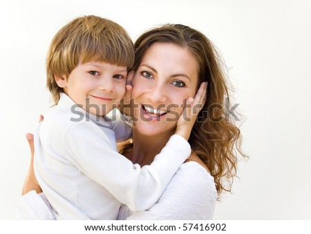 young mother with her son in her arms - stock photo