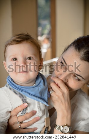 Young mother with her son in her arms.Portrait of a happy mother and baby laughing. Young mother holding her baby - stock photo
