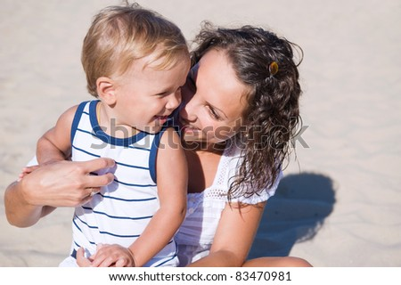 Young mother with her son on the beach