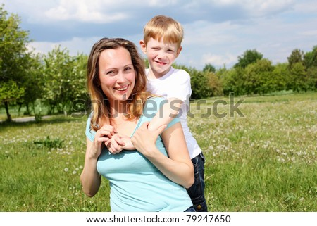 young mother with her son outdoors relaxing