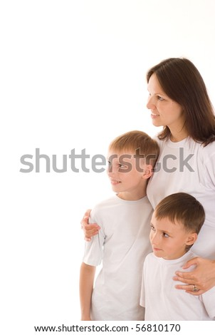 young mother with her two children - stock photo