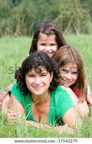 Young mother with her two daughters in a farmer´s field