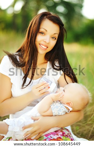young mother with infant, soft focus (focus on eyes of mother)