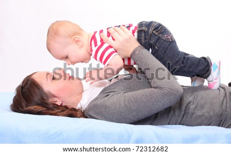 Young mother with little baby. - stock photo
