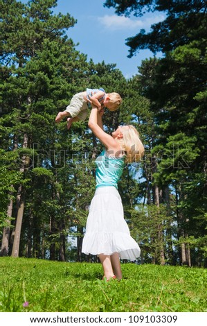 Young mother with little son at the park
