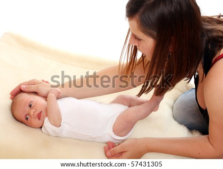Young mother with newborn daughter. - stock photo
