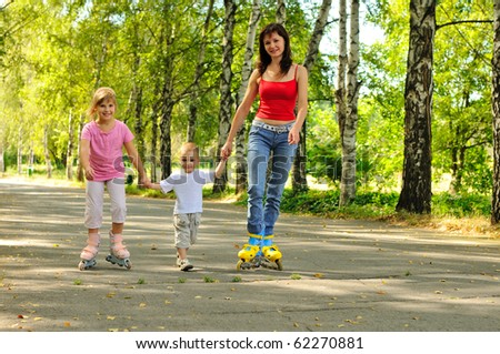 Young mother with rollers and her children - stock photo