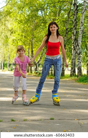 Young mother with rollers and her daughter - stock photo