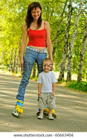 Young mother with rollers and her little son - stock photo