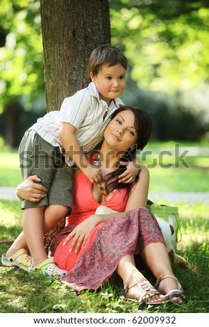 young mother with son in park