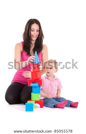 young mother with son play build blocks - stock photo
