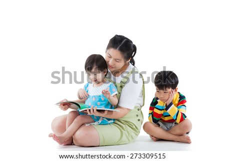 Young mother with two asian children (full body), daughter smiling and reading book, son feel bad and sitting on the floor (different gesture),some space for text message. Isolated on white background - stock photo