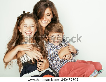 young mother with two children on white, happy smiling family inside isolated